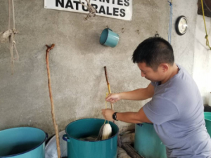 No, Juan is not cooking—he's preparing dyes for his artwork!